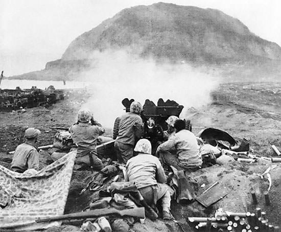 A U.S. 37 mm gun firing during the Battle of Iwo Jima