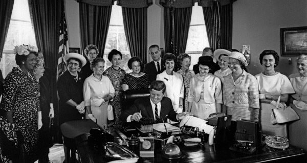 John F. Kennedy signs the Equal Pay Act into law