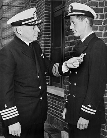John Kennedy being awarded the Navy and Marine Corps Medal