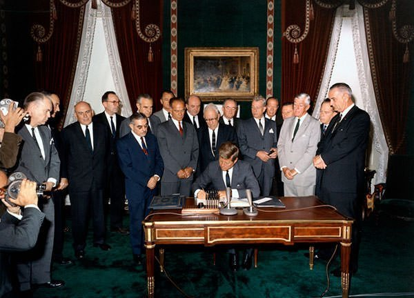 JFK signs the Limited Nuclear Test Ban Treaty