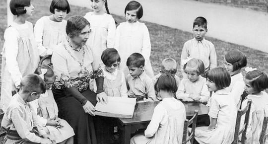 Helen Keller reading to blind children